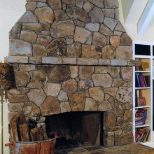 This rustic fireplace was designed and constructed for an addition to this country estate in Westport, CT. The fireplace, mantle and hearth were constructed of irregular shaped fieldstone, to match stonework at the residence and to achieve the effect of having been built at the same time as the original house.