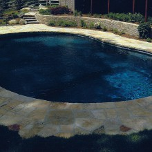 Pool in South Salem, NY with a mosaic patterned pool deck and Asher Bond stone wall.