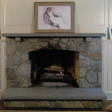 """This elegant grey fieldstone fireplace was constructed for a client in New Canaan, CT. Note the fieldstone lintels as a decorative element and the 3"""" bluestone mantle and hearth."""