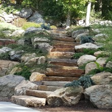 A long-time client wanted to add a tennis court to their property in Stamford, CT and asked us to incorporate it into the existing landscape. These steps were part of the project.