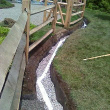 In back country Greenwich, we installed this trench drain in a low area of the yard to allow the garden, installed along the fence to drain properly and the plants to thrive.