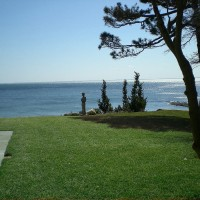 Overlooking the water in Westport, CT, our client asked us to find a place to nestle a special piece of sculpture in the landscape.  We designed a simple zen-like garden that shows off the sculpture and frames the stunning view of the water.