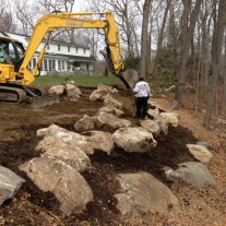This property in Old Greenwich, irregularly shaped and perched on a ridge, featured very little yard for the homeowners to utilize.  Building up and re-grading the back yard has created a wonderful open space for recreation and fun.