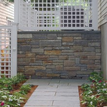 This random pattern bluestone walk set in stone dust, leads the viewer through a small garden in Old Greenwich.