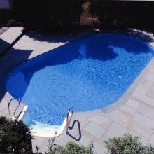 Renovated pool deck and coping in Darien, CT using random pattern bluestone.