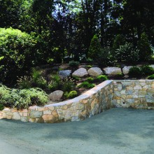 This is another view of the previous fieldstone retaining wall. Note the plantings around the new parking, to soften the large but necessary wall.