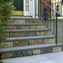 The front entry steps at this home in North Stamford were falling down. We rebuilt the old cement steps, replacing them with rock faced bluestone treads and fieldstone risers. These steps are built to last and add significantly to the curb appeal of this home.