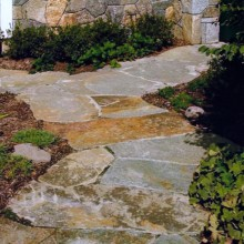 In South Salem, NY, this irregular fieldstone path set in cement wends through as simple perennial garden.