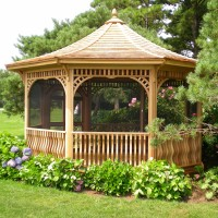 This elegant gazebo, overlooking the Long Island Sound on a Westport estate, is surrounded with lush and colorful plantings to create a feeling of privacy and solitude.