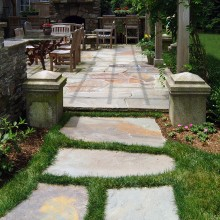 This irregular fieldstone path in Westport made of large stones set in the lawn beckons the walker for a leisurely stroll.
