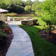 In Westport, a path made of bluestone – set in random pattern in cement.
