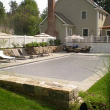 This 20' x 40' pool in New Canaan, CT was built for exercise and entertaining. The large bluestone patio accomodates large groups for summer entertaining.