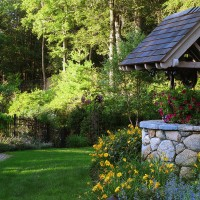 In this wooded setting in New Canaan, CT, the challenge was to design garden rooms that would act as an extension of the home into the woods beyond. We designed naturalistic plantings and added a touch of whimsy with sculpture and a beautifully constructed fieldstone well.