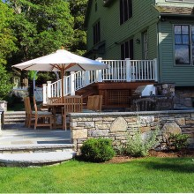 The sophisticated and clean lines of this outdoor terrace were a collaboration with our client in Katonah, NY. The fieldstone walls and rock face bluestone coping are attractive and functional. The rock face finish of the step treads ties in with the sitting wall coping. Not the semi-circular tread of the step leading into the terrace from the lawn.