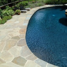 This lovely pool in Westport, CT was constructed with irregular-shaped Pennsylvania bluestone in a mosaic pattern.