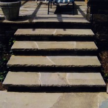 This inviting set of steps created for a client in Westport, CT were constructed to compliment the terrace of irregular shaped fieldstone. Notice how the steps mimic the irregular stone of the terrace. The rock face of the treads completes the look.
