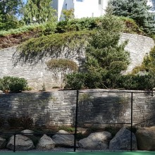 A long-time client wanted to add a tennis court to their property in Stamford, CT and asked us to incorporate it into the existing landscape which included ontinuation of an existing stone wall (our previous work).