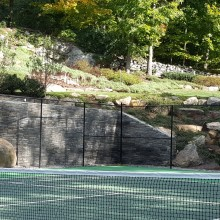Additional retaining walls, and extensive drainage were part of the same project.